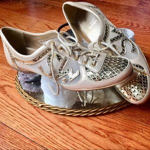 STUART WEITZMAN gold sneakers size 7